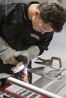 Boy welding metal