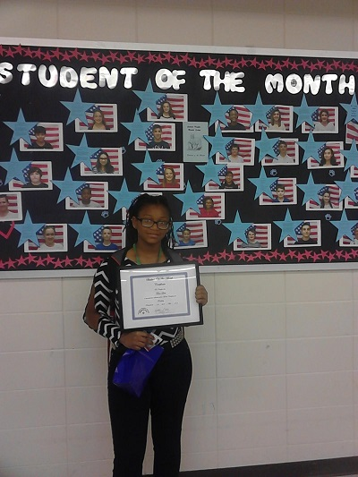 Youth Tekoa poses with her Student of the Month award.
