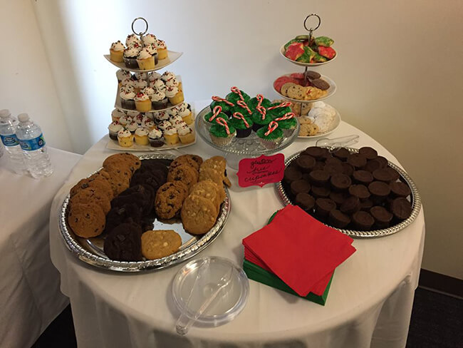 A table of cookies and cupcakes