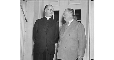 Boys Town's founder, Father Edward Joseph Flanagan, left, visits the White House. Image courtesy of Library of Congress.