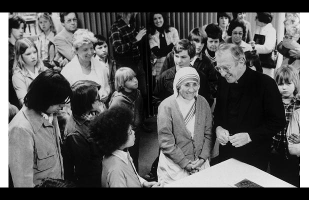 Mother Teresa with the late Msgr. Robert P. Hupp, executive director of Boys Town, on her 1976 tour of the Boys Town campus.