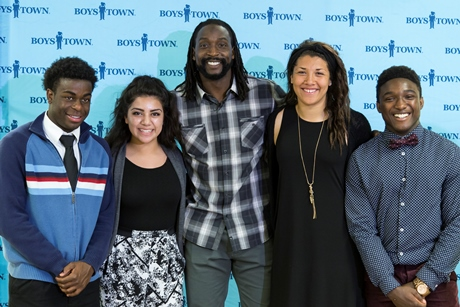 Charles Tillman with Boys Town High School athletes.