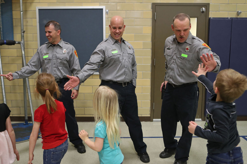 FD high fives kids
