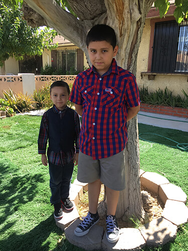 Brothers Erick (left) and Adrian have been inspired by their mom's tenacity and love.