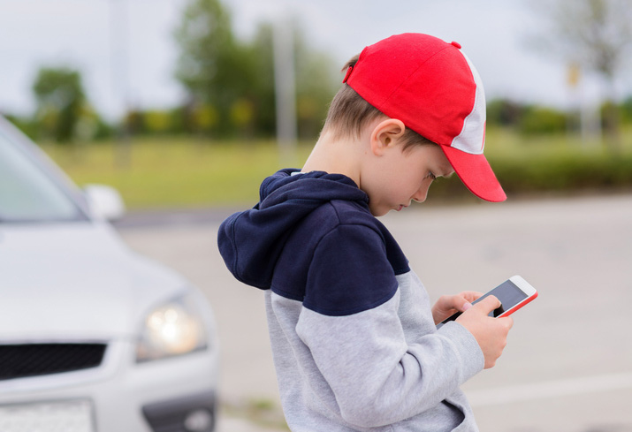 Child looking at cell phone