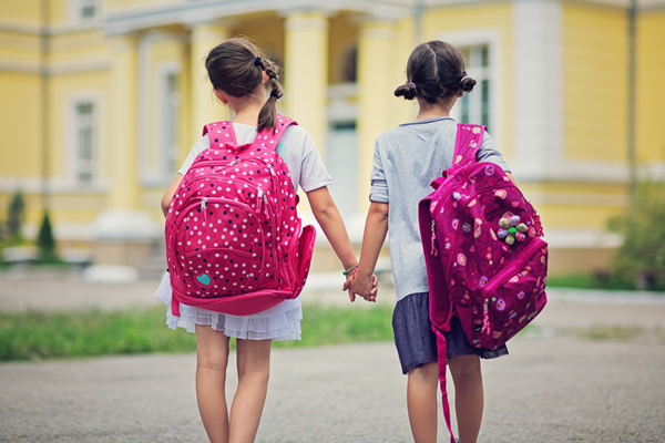 Young girls walking hand in hand