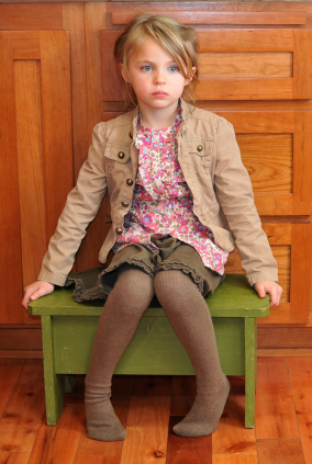 Girl sitting on timeout chair
