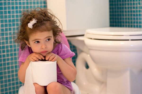 Girl looking stressed holding toilet paper